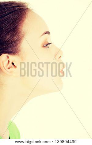 Attractive woman's profile. Closeup.
