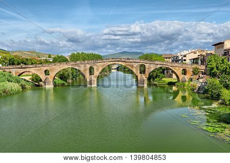 Ancient roman bridge across the Arga river in Puente la Reina near Pamplona Navarra Spain