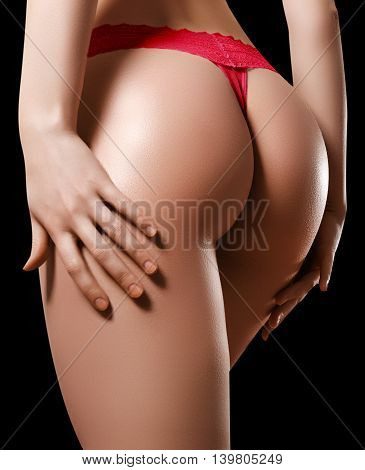 Beautiful Female Body Part. Sexy Female Buttocks Isolated On Bla