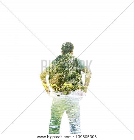 Double exposure of backpacker standing on waterfall on white background.