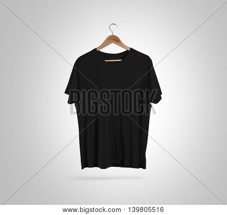 Blank black t-shirt front side view on hanger, design mockup, clipping path. Gray clear plain cotton tshirt mock up template. Apparel store logo branding display. Crew shirt surface hang wood hanger