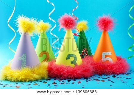 Party hats cone on color background
