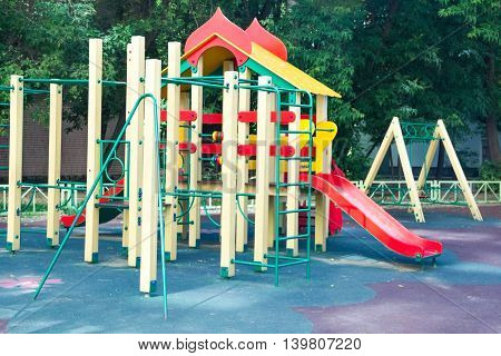 Playground and swings in colorful park the concept of physical development children active holidays