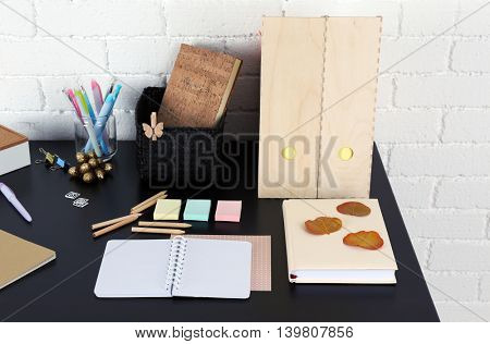 Office and school set with stationery and notebooks on a table