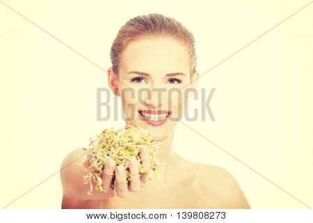Beautiful caucasian woman with green cress.