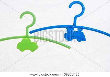 colored hanger coat rack for infants clothing and a colorful rattle toy