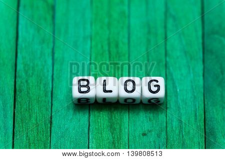 Blog Cube Blocks Arranged On Green Wooden Background