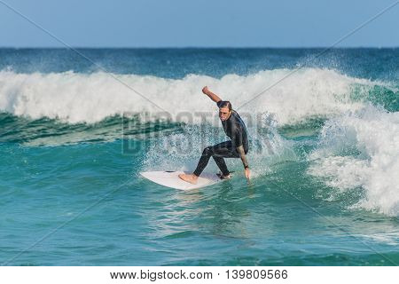 Sydney Australia - November 26 2014: A Australian surfer on the wave Bondi Beach in the Eastern Suburbs Sydney New South Wales Australia.