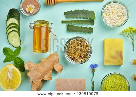 Natural ingredients for skin care on blue background
