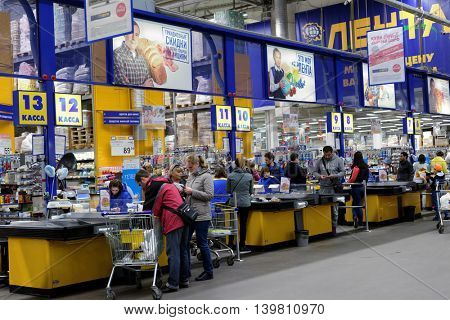 ST. PETERSBURG, RUSSIA - JUNE 9, 2016: People in hypermarket Lenta. Founded in 1993, Lenta now has 147 hypermarkets, 42 supermarkets, and 6 distribution centers in Russia
