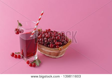 Cherries And A Glass Of Cherry Juice On Pink Background