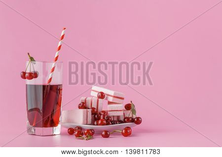 Glass Of Fresh Juice With Cherries On Bright Background