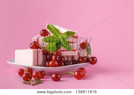 Plate With Sweet Marshmallow On Pink Table With Cherries