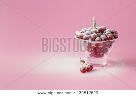 Raw Fresh Cherries In Glass With Sugar Powder