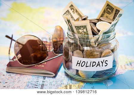 Holidays Budget Concept With Passport And Sunglasses