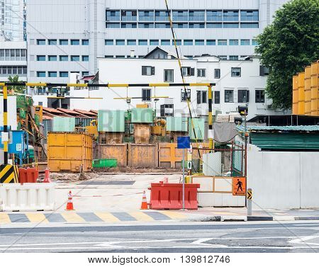 Construction site of the underground station in the urban area.
