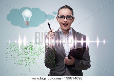 Young woman in bright idea concept