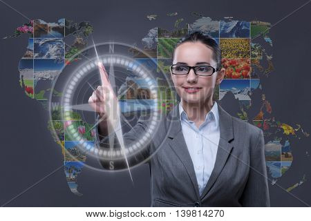 Woman pressing virtual button with nature photos