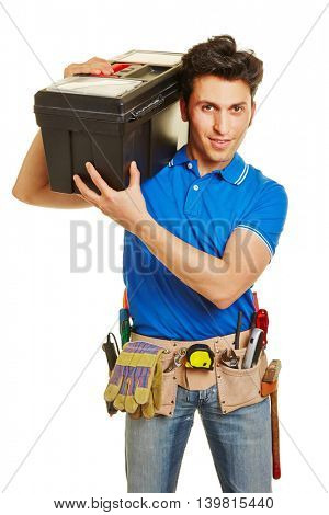 Handyman with tool belt carrying toolbox on his shoulder