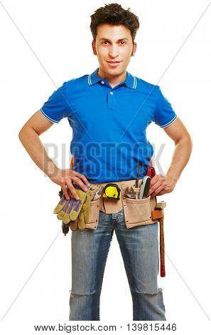 Smiling craftsman with a tool belt