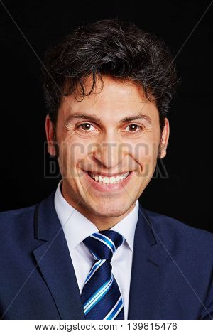Head shot of smiling business man on a black background