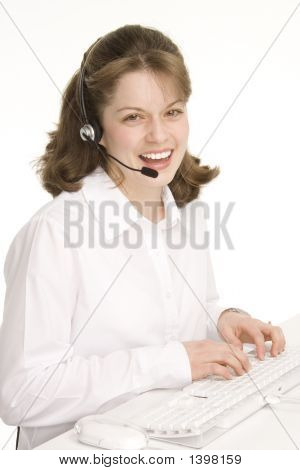 Receptionist With Headphones, Smiling, Keyboard, Mouse