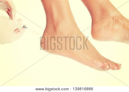 Woman getting an foot injection