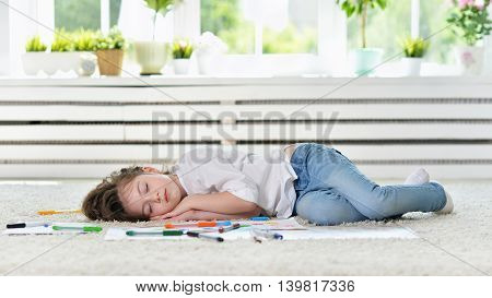 Cute student girl sleeping during art class