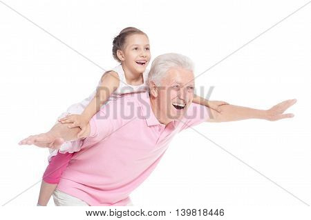 Happy elderly man with  cute granddaughter on white background