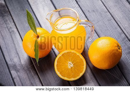 orange juice in the jug on the table