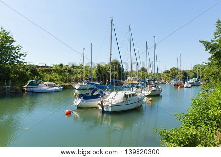 Boats in Lydney harbour Gloucestershire England uk west bank of the River Severn close to the Forest of Dean and Wye valley