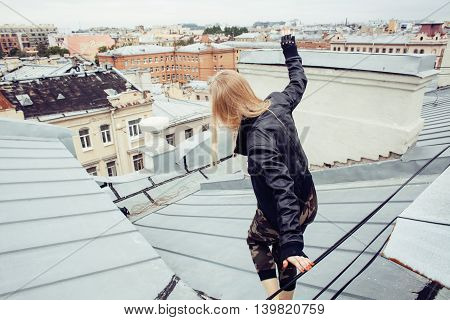 young pretty fashion lady on roof top having fun party time, lifestyle people concept danger