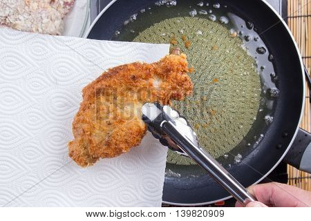 Chef keeping deep fried pork from pan / cooking Japanese pork curry paste concept