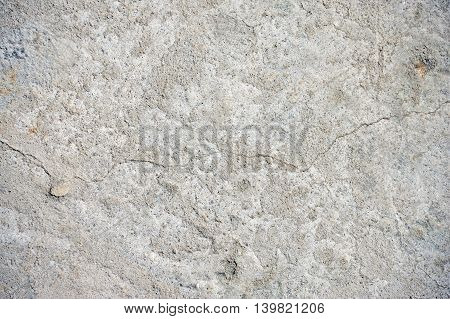 Gray cracked concrete texture background close up