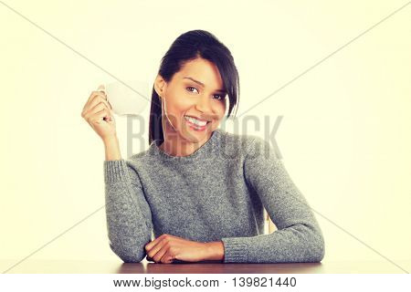 Young woman drinking something from big mug