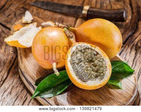 Granadilla fruits on the wooden table.