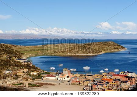 Unusual view on the lake Titicaca and the village
