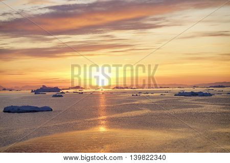 Sunset time to Ilulissat fjord at Greenland