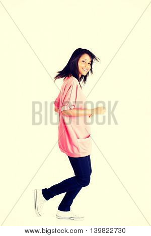 Happy student girl running