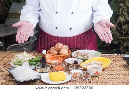 Chef present ingredient of Pad Thai / cooking Pad Thai concept