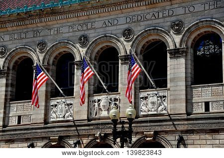 Boston Massachusetts - July 14 2013: Italianate Renaissance facade of the 1888 Boston Public Library in Copley Square designed by McKim Mead and White