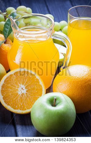 fresh fruit and juice in the jug vertical photo still life