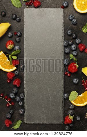 Black board, fruits  and berries. Template for recipes or food menu