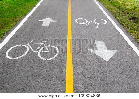 Bicycle Sign And Arrow Sign On The Road