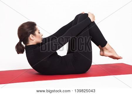 Beautiful athletic girl in black suit doing yoga. exercise for stretching the hands of the arms . Isolated on white background.