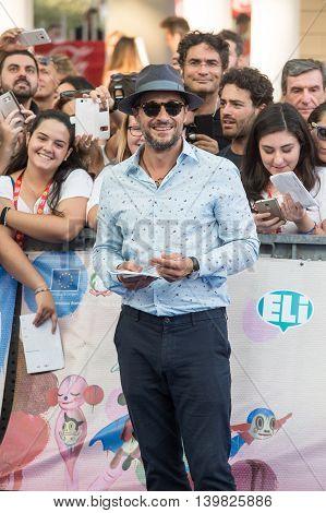 Giffoni Valle Piana SA ITALY - July 23 2016: Actor Claudio Santamaria on blue carpet during 46th Giffoni Film Festival 2016 - on July 23 2016 in Giffoni Valle Piana Italy.