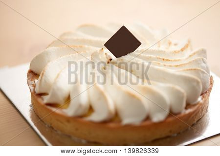 Close up of cake decorated with whipped cream