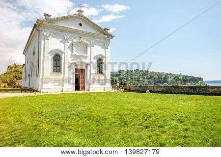 Entrance facade of St. George's church in Piran city in Slovenia