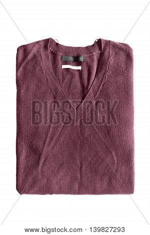 Folded wool maroon pullover on white background