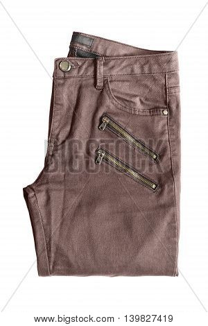 Brown folded pants with zippers isolated over white